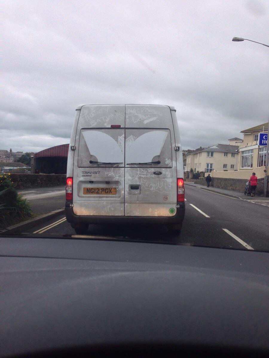 This van has no rear window, but  it has rear wipers - meme