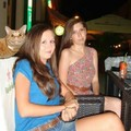 The cat is having a better time than either of these girls...