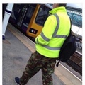 confused man in camo and hi-vis