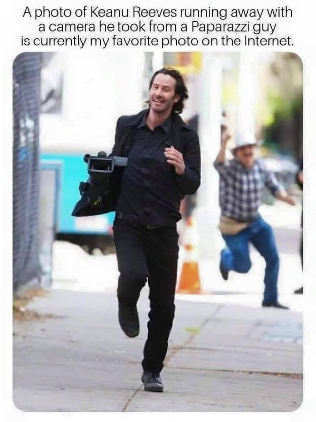 A photo of Keanu Reeves running away with a camera he took from a Paparazzi - meme