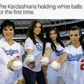 The kardashians holding white balls for the first time