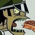 Murdoc comiendo alfajor :0