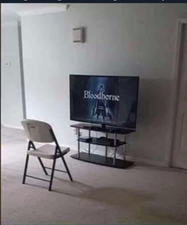 Every thing that a guy need TV , a good game , chair(this one is not that necessary) - meme