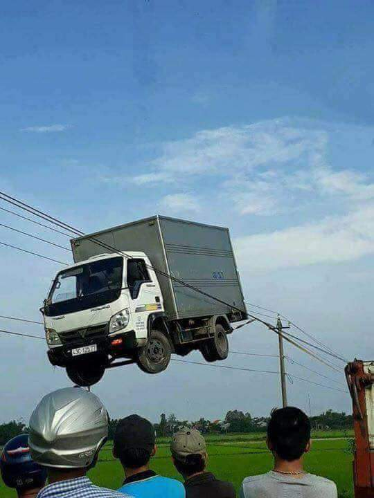 Thailand invent lorry can go on electric cable.. still testing it. - meme