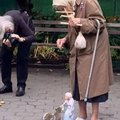 Old lady with puppet that looks like her feeding squirrel