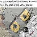 Popcorn bag into the microwave
