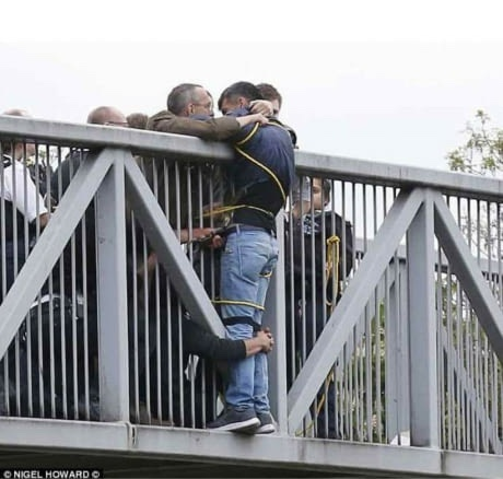 London, a man contemplating suicide, held for an hour by strangers until help arrived to get him down safely. - meme